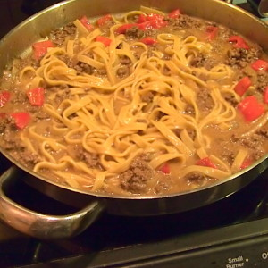 fettuccine with cheesy meat sauce
